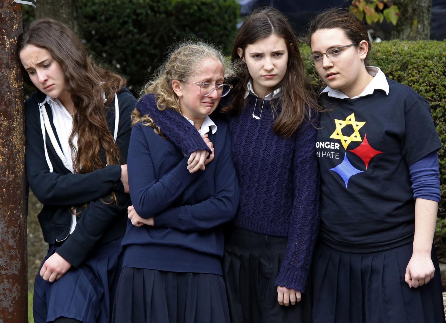 Students from a school near Squirrel Hill react following a funeral service at the Jewish Community Center on Tuesday Oct. 30, 2018.