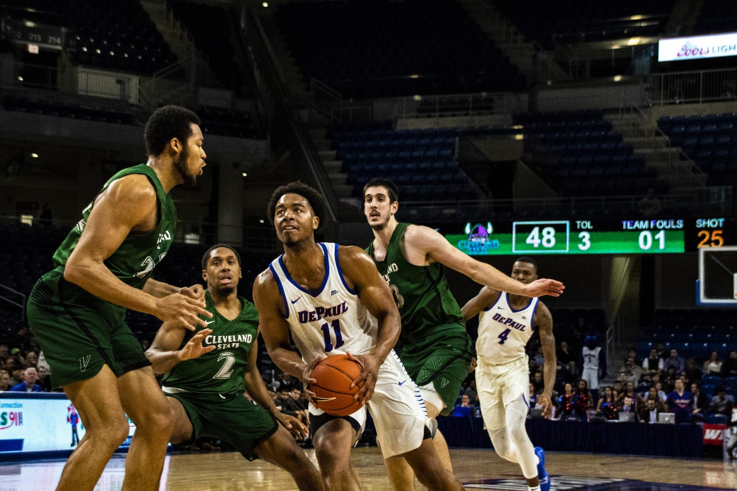 DePaul senior guard Eli Cain drives to the rim with Cleveland State defenders Jaalam Hill (left), Kasheem Thomas (center) and Stefan Kenic (right) looking on. Richard Bodee | The DePaulia