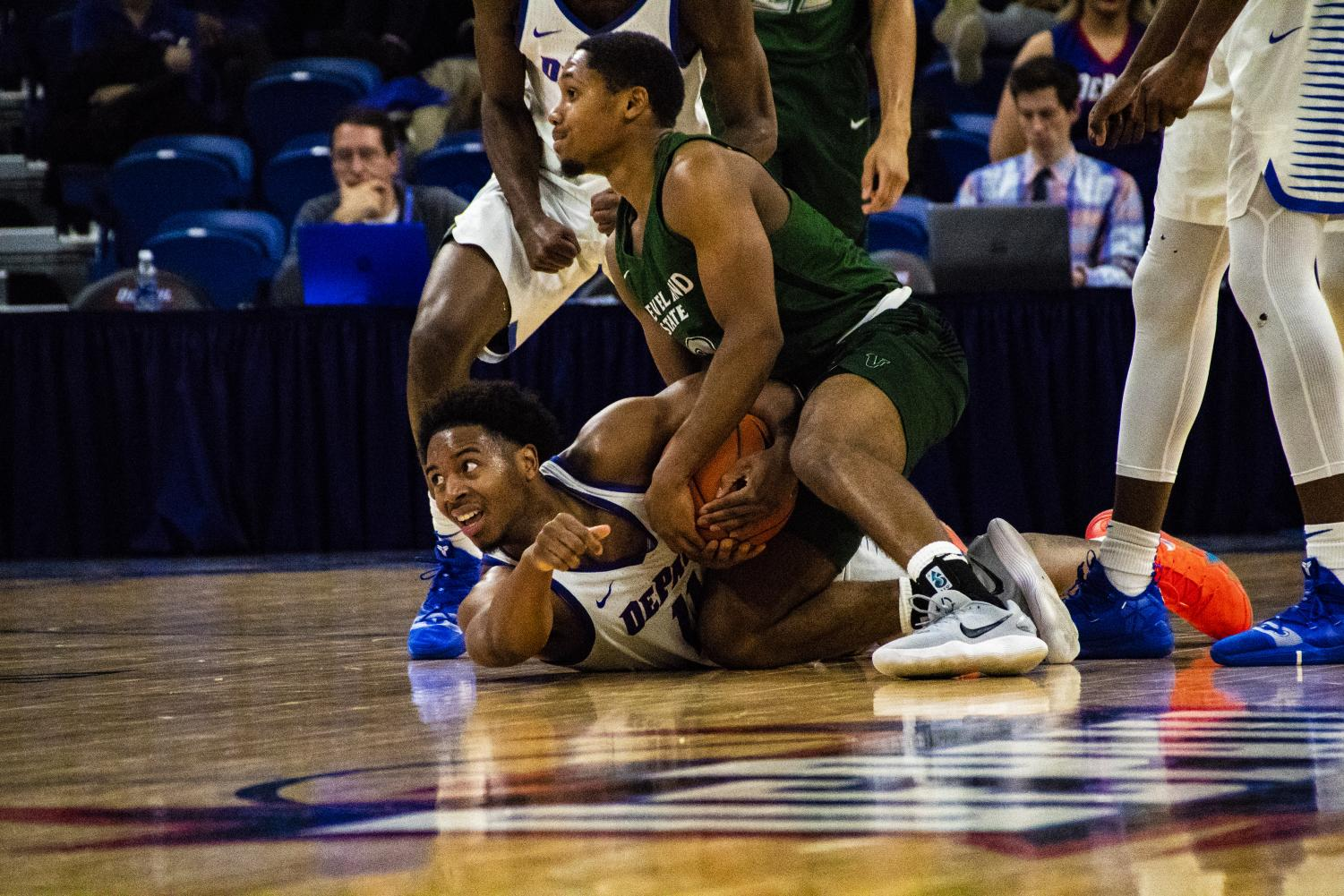 DePaul senior Eli Cain dives for a loose ball during the Blue Demons 83-73 win against Cleveland State Wednesday. Richard Bodee I The DePaulia