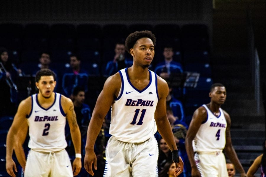 DePaul senior Eli Cain flanked by sophomores Jaylen Butz and Paul Reed get ready for a defensive possession against Rockhurst on Thursday night.  Richard Bodee | The DePaulia