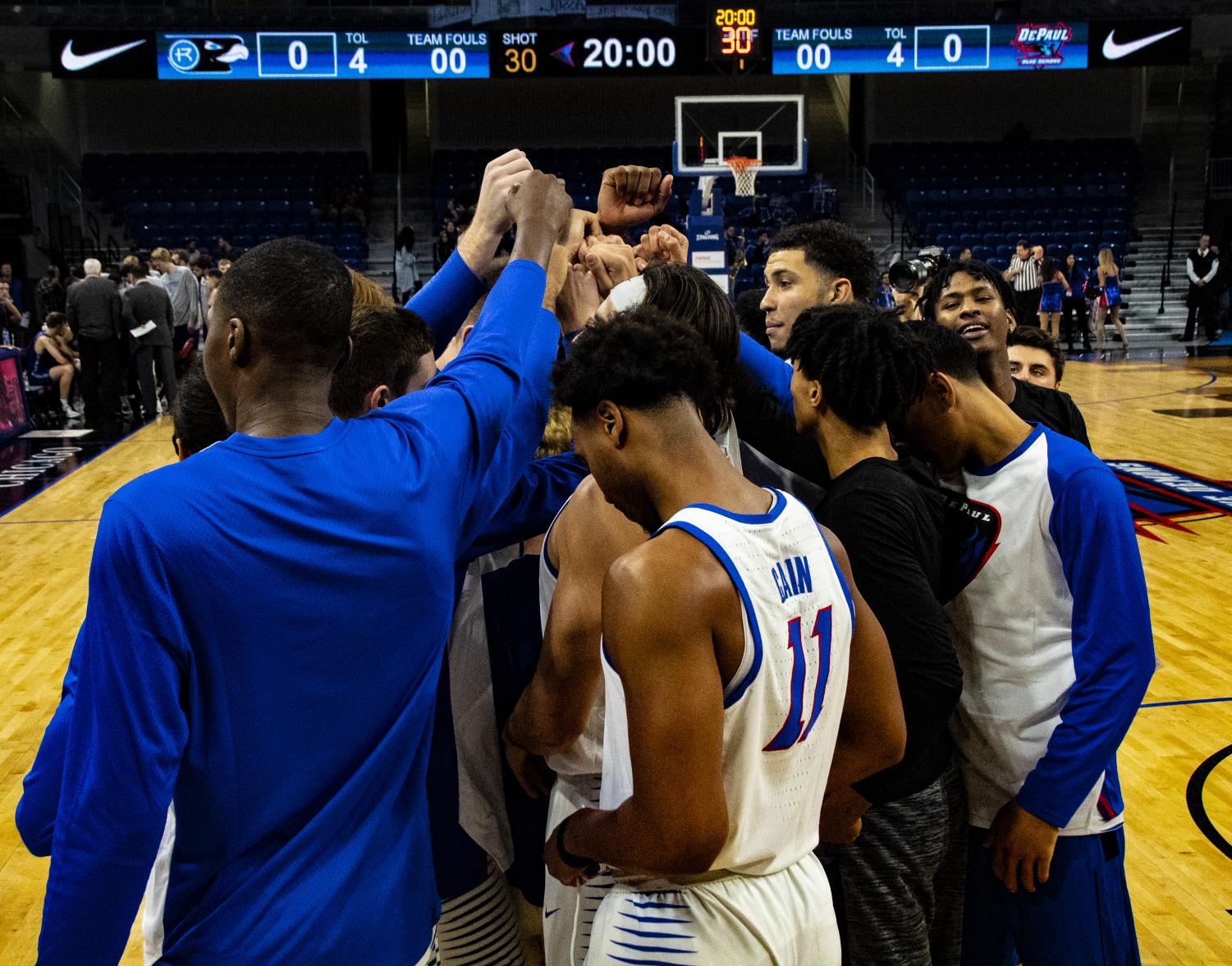 The DePaul Blue Demon men's basketball team huddles before a game. [Richard Bodee-The DePaulia]