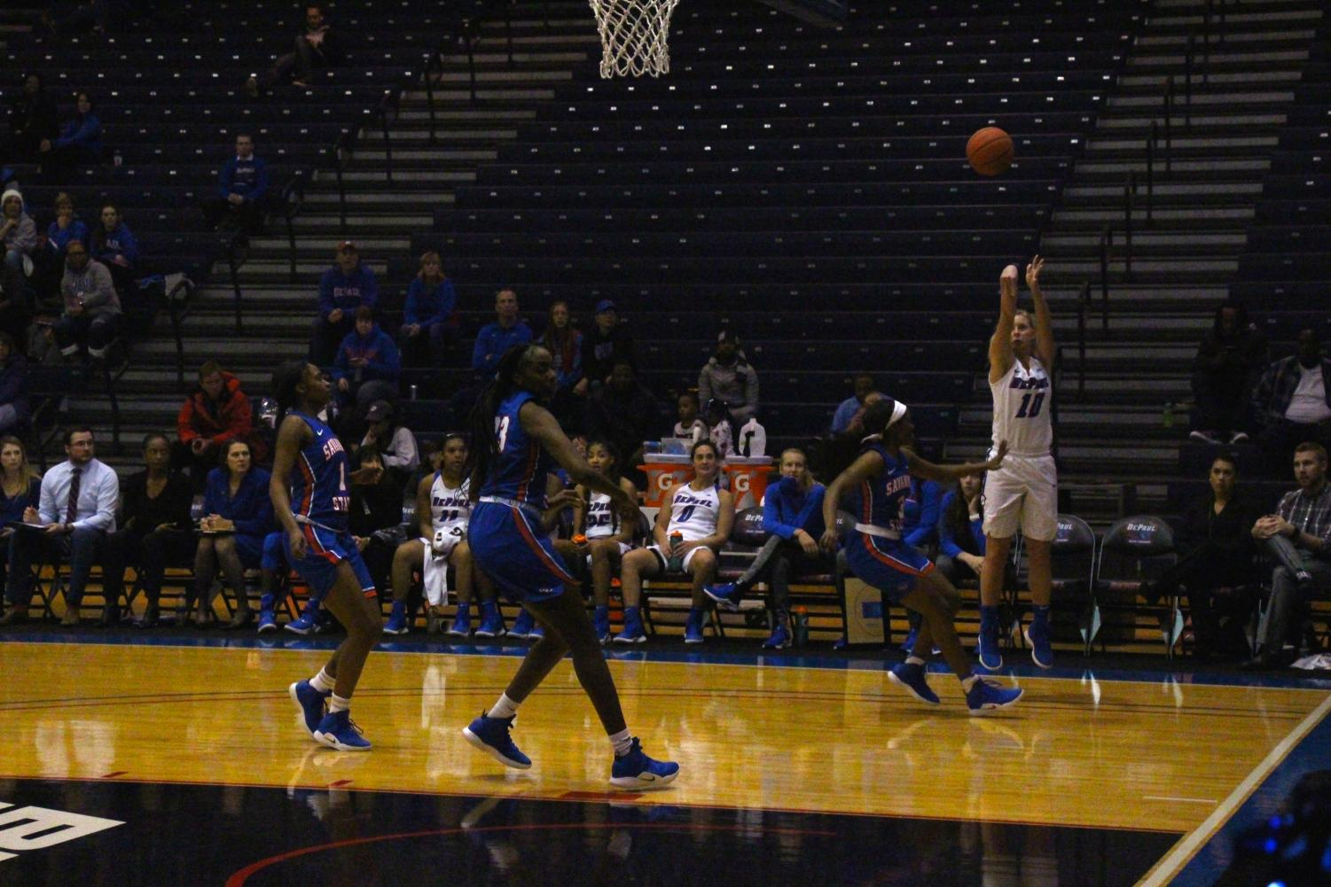 Freshman guard Lexi Held attempts a 3-point shot Monday night in DePaul's 124-61 victory over Savannah State. Andrew Hattersley | The DePaulia