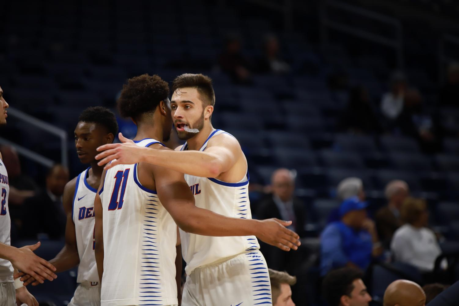 DePaul seniors Eli Cain and Max Strus celebrate the Blue Demons 80-58 victory over Bethune-Cookman on Wednesday night.