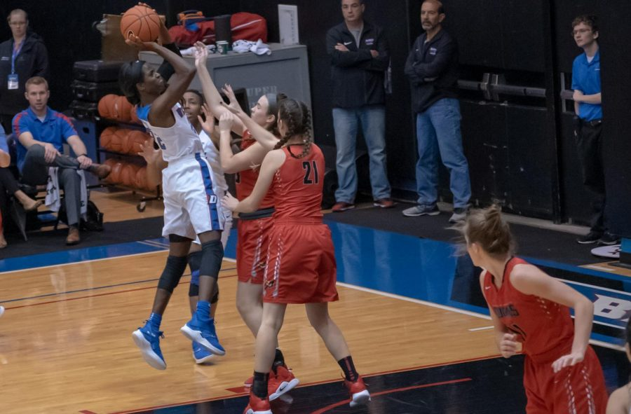 DePaul junior Chante Stonewall shoots over St. Xavier freshman center McKenna Zobel and senior center Emily Gorsch during DePaul's win St. Xavier.  Jonathan Aguilar | The DePaulia