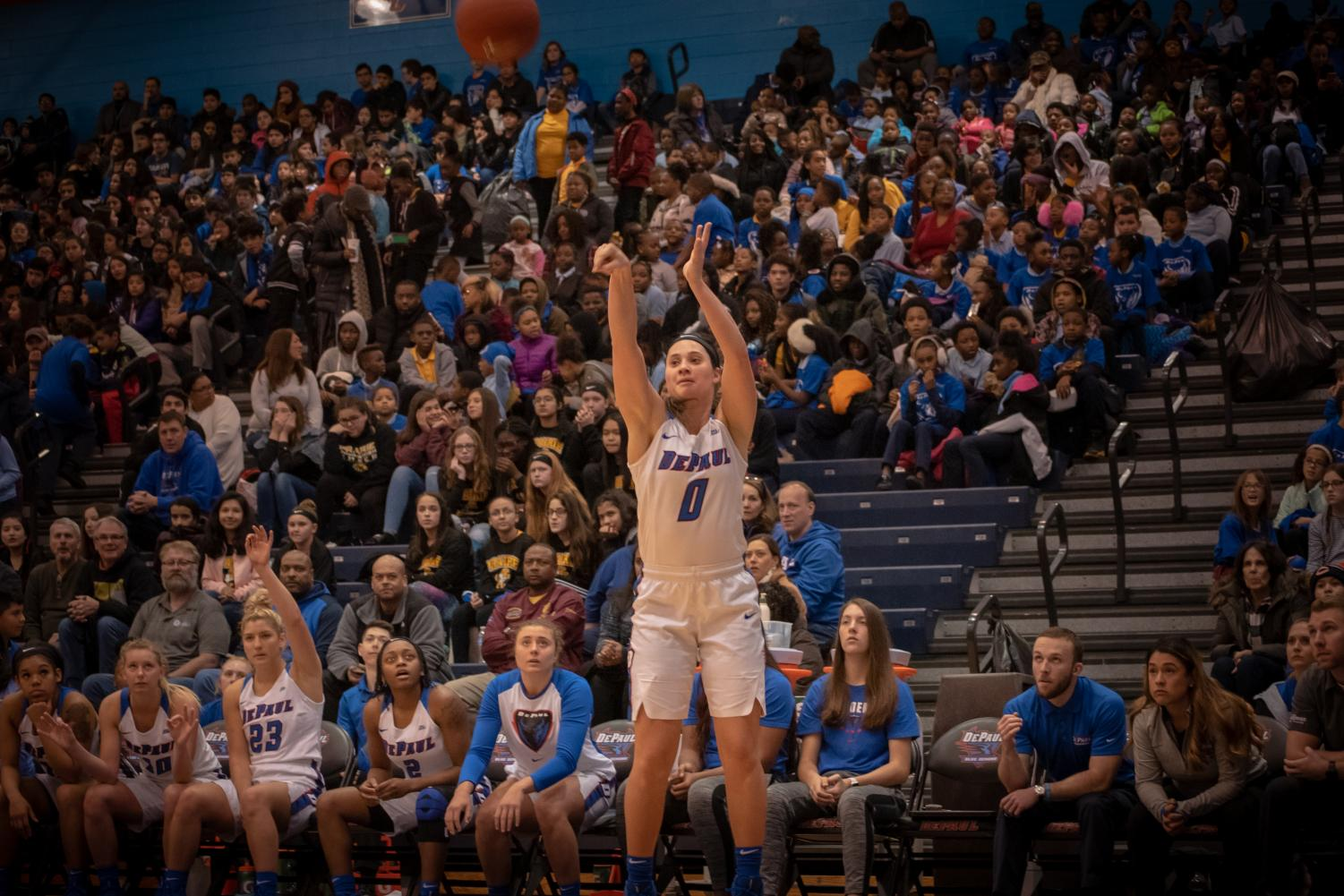 Senior guard Rebekah Dahlman rises for a 3-point attempt during DePaul's 102-88 victory over Temple Monday afternoon at McGrath-Phillips Arena. Jonathan Aguilar | The DePaulia