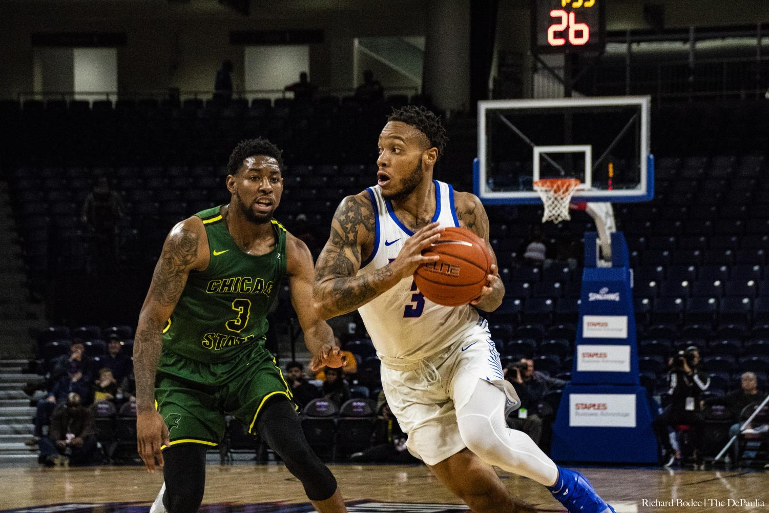 DePaul sophomore guard Devin Gage drives past Chicago State guard Savon Bell Wednesday night at Wintrust Arena. Richard Bodee | The DePaulia