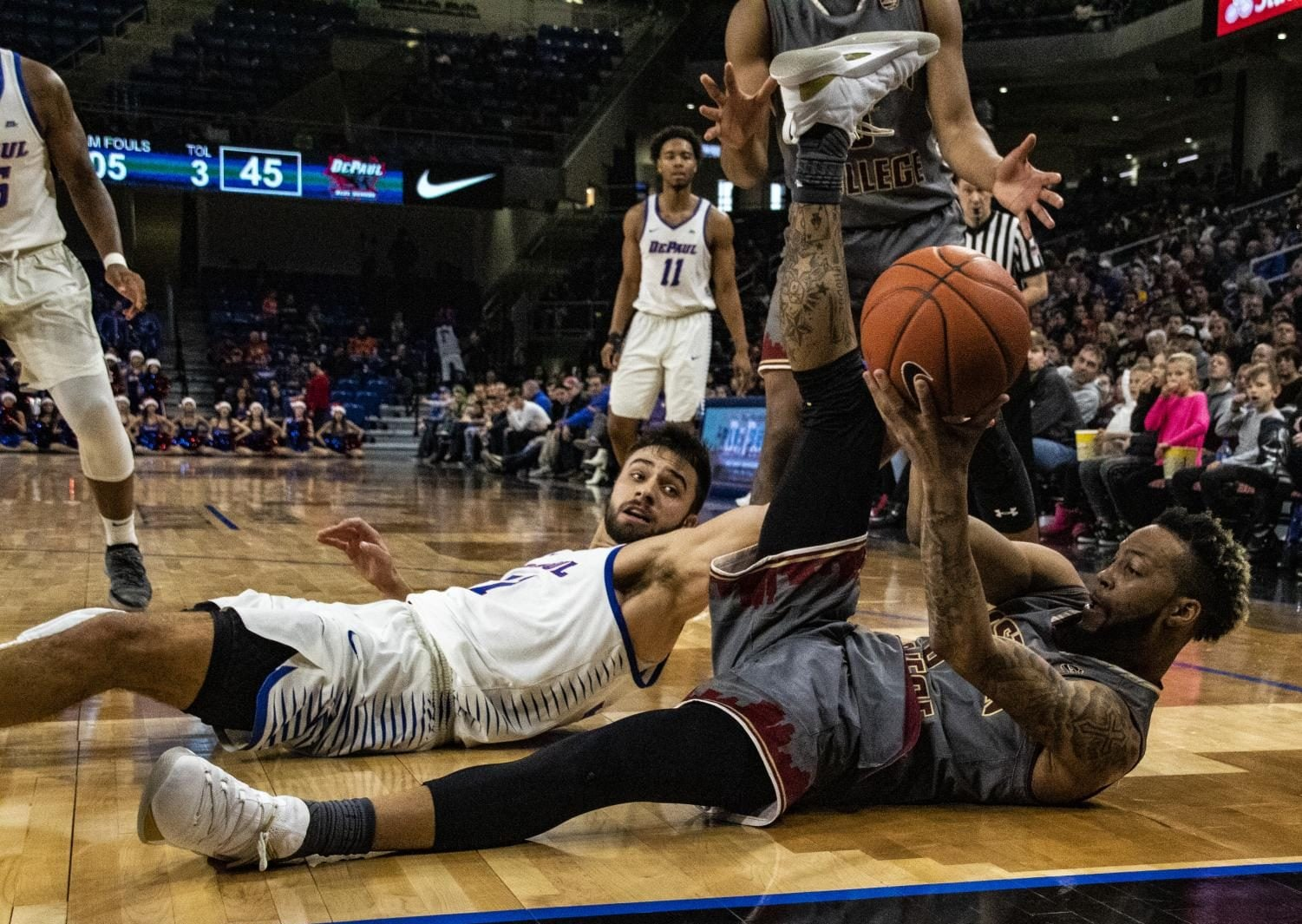Senior guard Max Strus dives for a loose ball during the second half of DePaul's loss to Boston College. Richard Bodee | The DePaulia