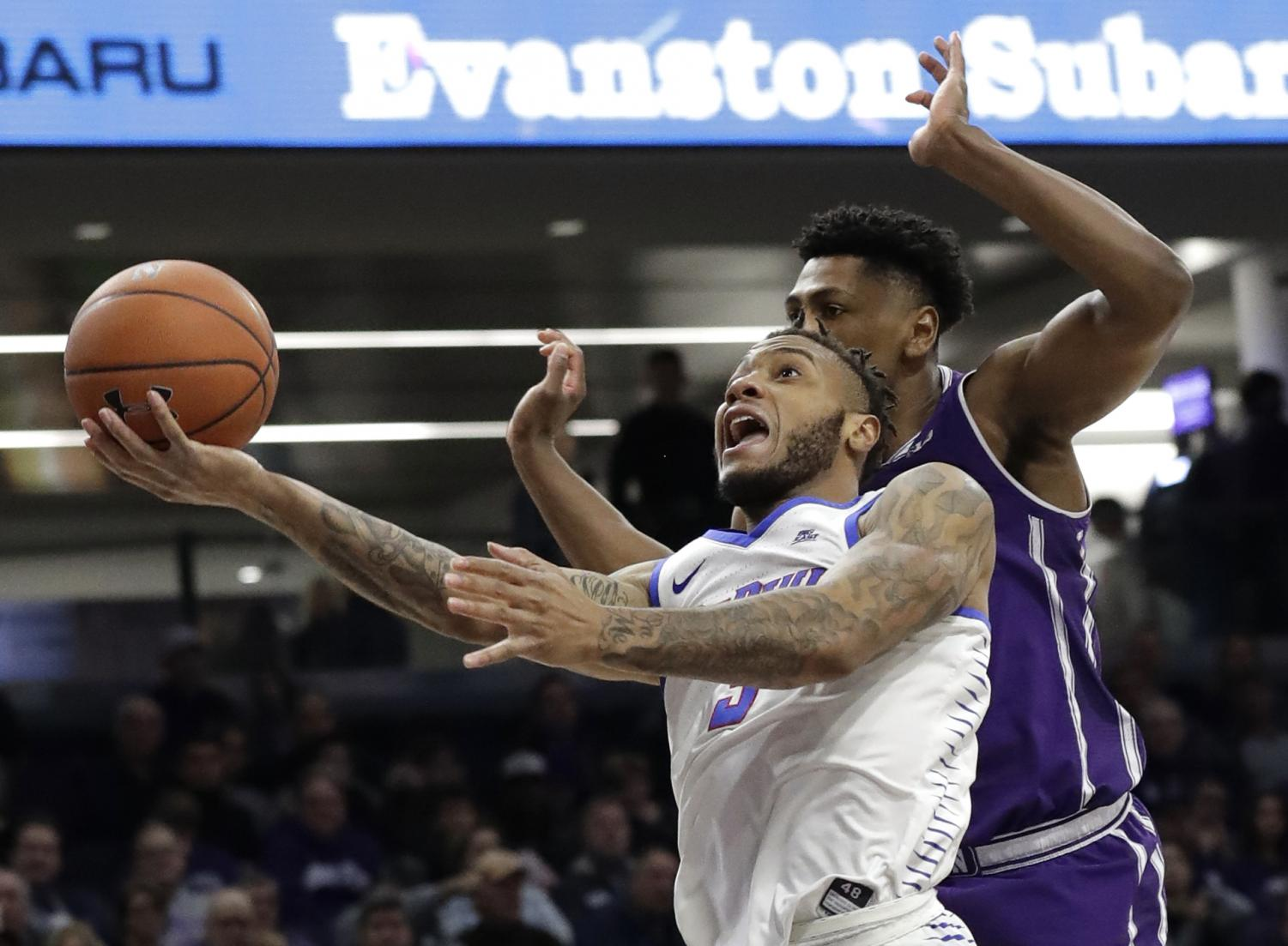 DePaul guard Devin Gage, left, drives to the basket past Northwestern guard Anthony Gaines during the first half of an NCAA college basketball game Saturday, Dec. 8, 2018, in Evanston, Ill. Nam Y. Huh | AP
