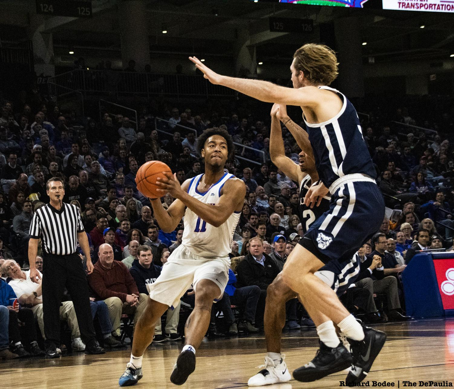 DePaul senior guard Eli Cain drives to the basket against Butler defenders Joey Brunk and Aaron Thompson. Cain finished with eight points and four assists.