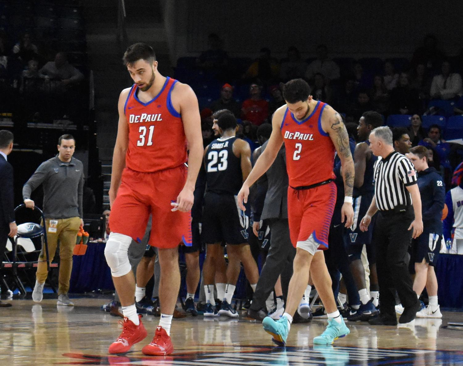 DePaul sophomore forward Jaylen Butz and senior guard Max Strus head to an official television timeout during the Blue Demons 86-74 loss against Villanova on Wednesday night. Andrew Hattersley I The DePaulia