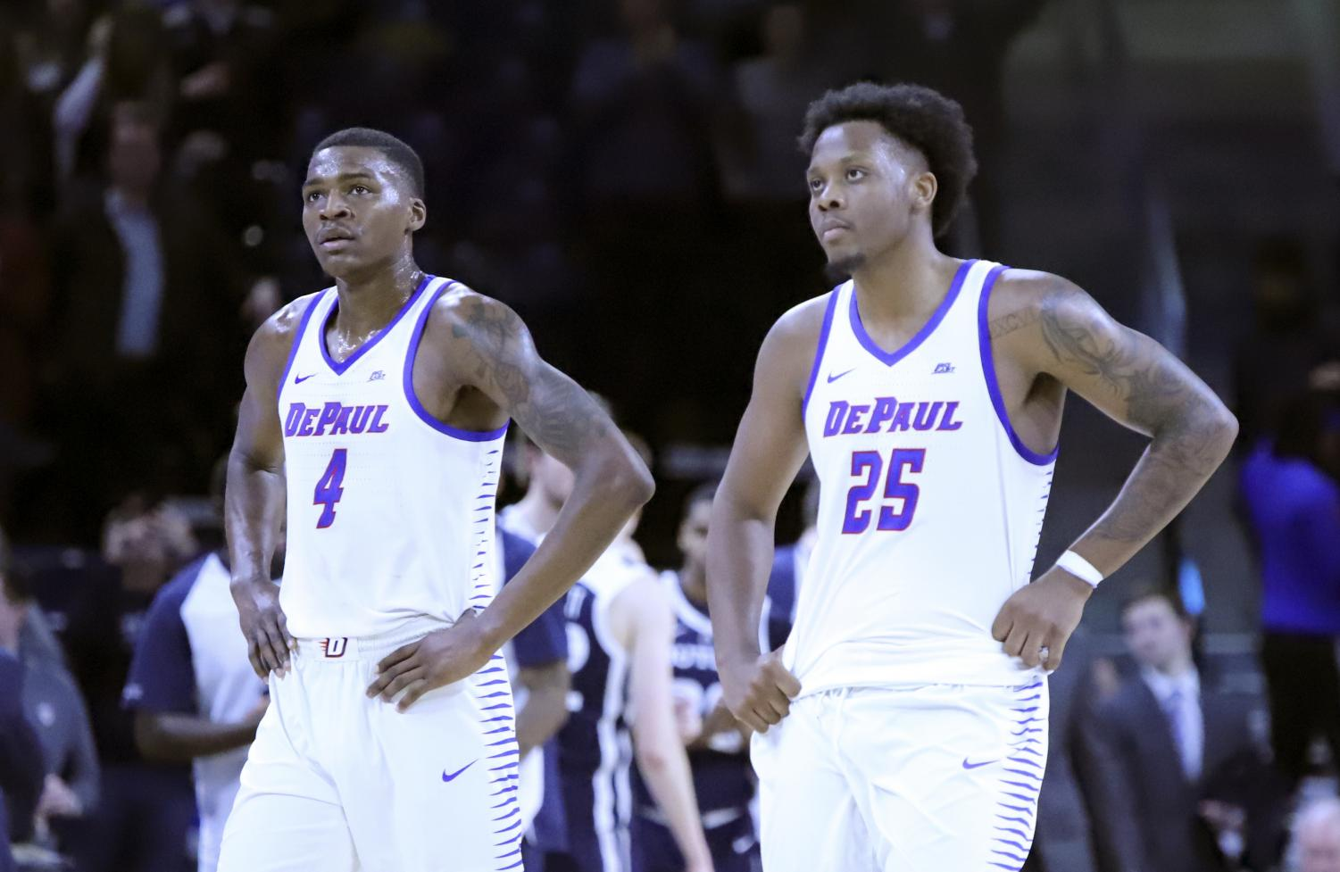 Sophomore forward Paul Reed and senior forward Femi Olujobi look on during DePaul's loss to Butler on Jan. 16 at Wintrust Arena.
