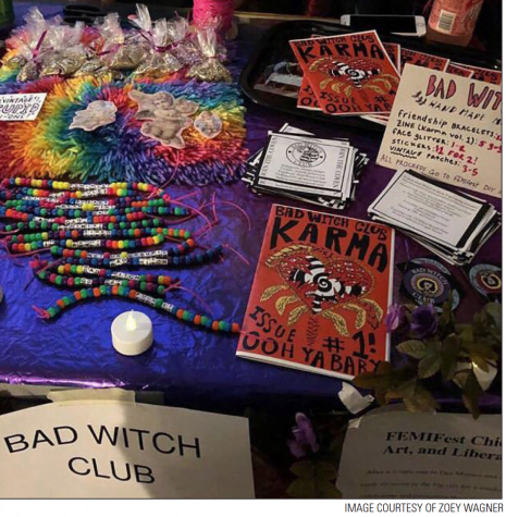 A stand of Bad Witch Club memorabilia at the goth prom fundraiser.