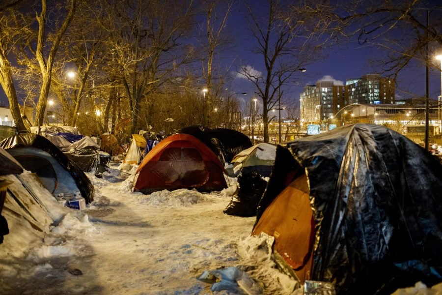 People sleep in tents near a wooded area adjacent to the Dan Ryan Expressway on Tuesday, Jan. 29. Officials throughout the region were focused on protecting vulnerable people from the cold.