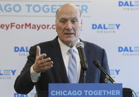 Bill Daley speaks during a news conference in Chicago on Feb. 8. Daley is aiming to follow in his father and brother's footsteps by running for mayor.