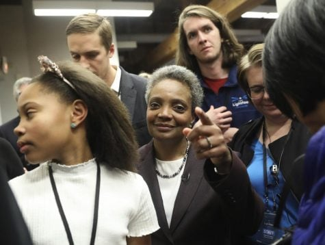 Mayoral candidate Lori Lightfoot and her daughter Vivian Lightfoot appear with supporters at EvolveHer in Chicago Tuesday, Feb. 26, 2019. (Erin Hooley/Chicago Tribune via AP)