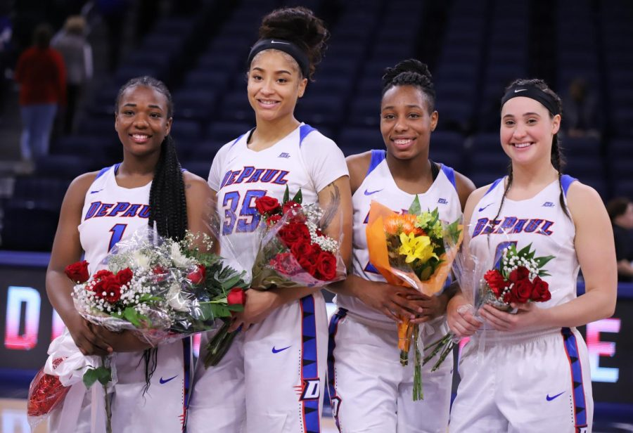 DePaul+seniors+%28left+to+right%29+Ashton+Millender%2C+Mart%27e+Grays%2C+Tanita+Allen%2C+and+Rebekah+Dahlman+stand+at+center+together+for+a+picture+during+the+senior+day+ceremony+Sunday+afternoon+at+Wintrust+Arena.+Alexa+Sandler+%7C+The+DePaulia+