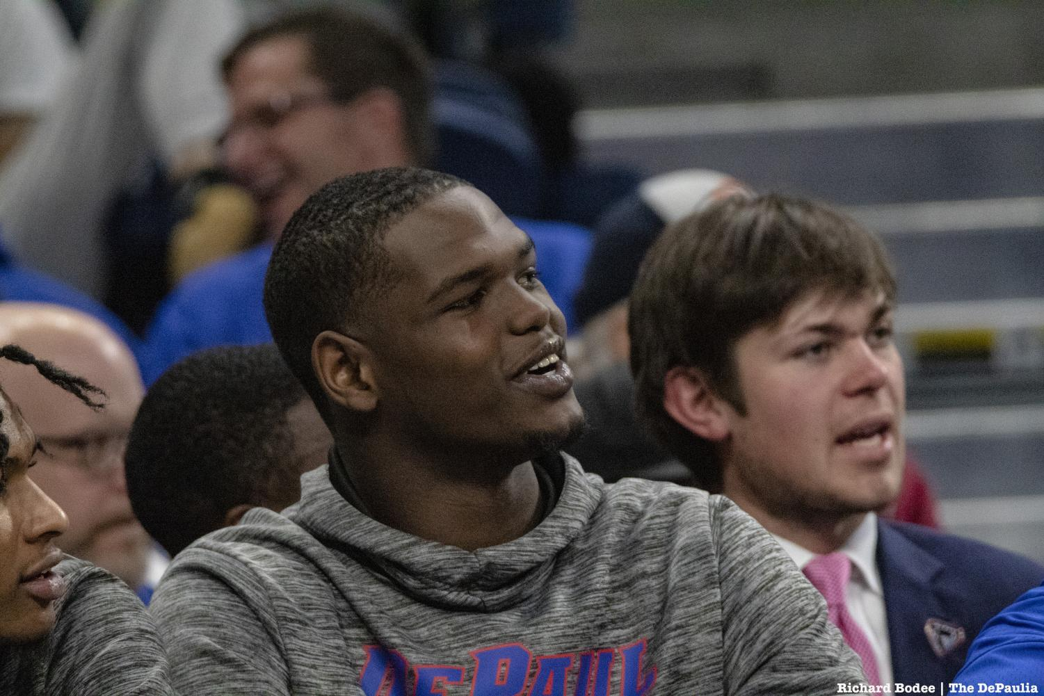 DePaul's newest transfer Carte'Are Gordon watches the Blue Demons battle the Butler Bulldogs.