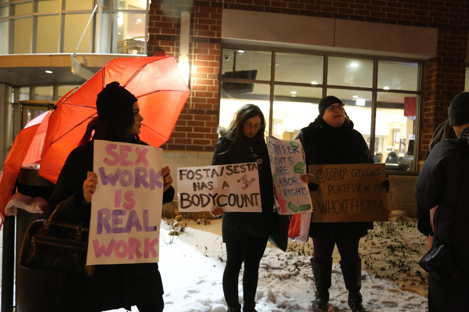 Current and former sex workers and supporters of the profession stand outside the Lincoln Park Student Center in protest on Wednesday of XXX: Love and Life in a Post-Porn World.