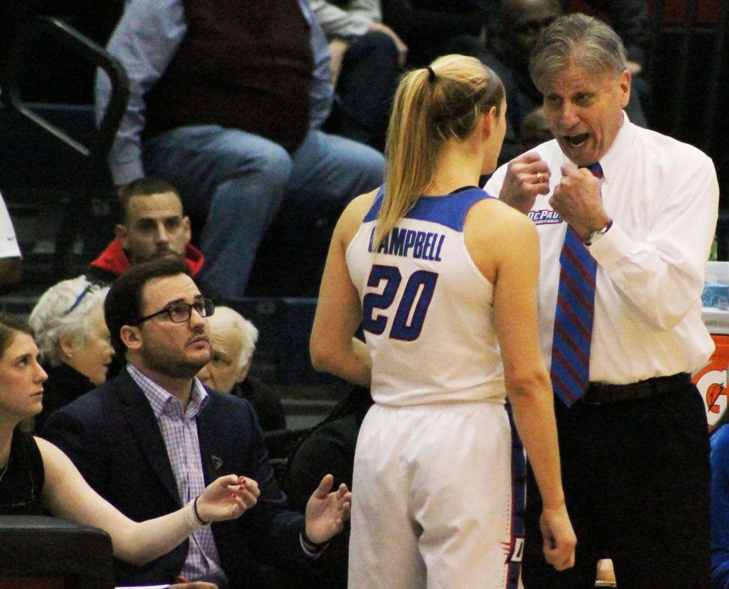 Head coach Doug Bruno talks to junior guard Kelly Campbell in the fourth quarterof DePaul's  93-87 loss to Marquette Sunday afternoon at McGrath-Phillips Arena.