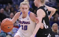 DePaul guard Lexi Held drives to the basket against Butlers Whitney Jennings at Wintrust Arena.