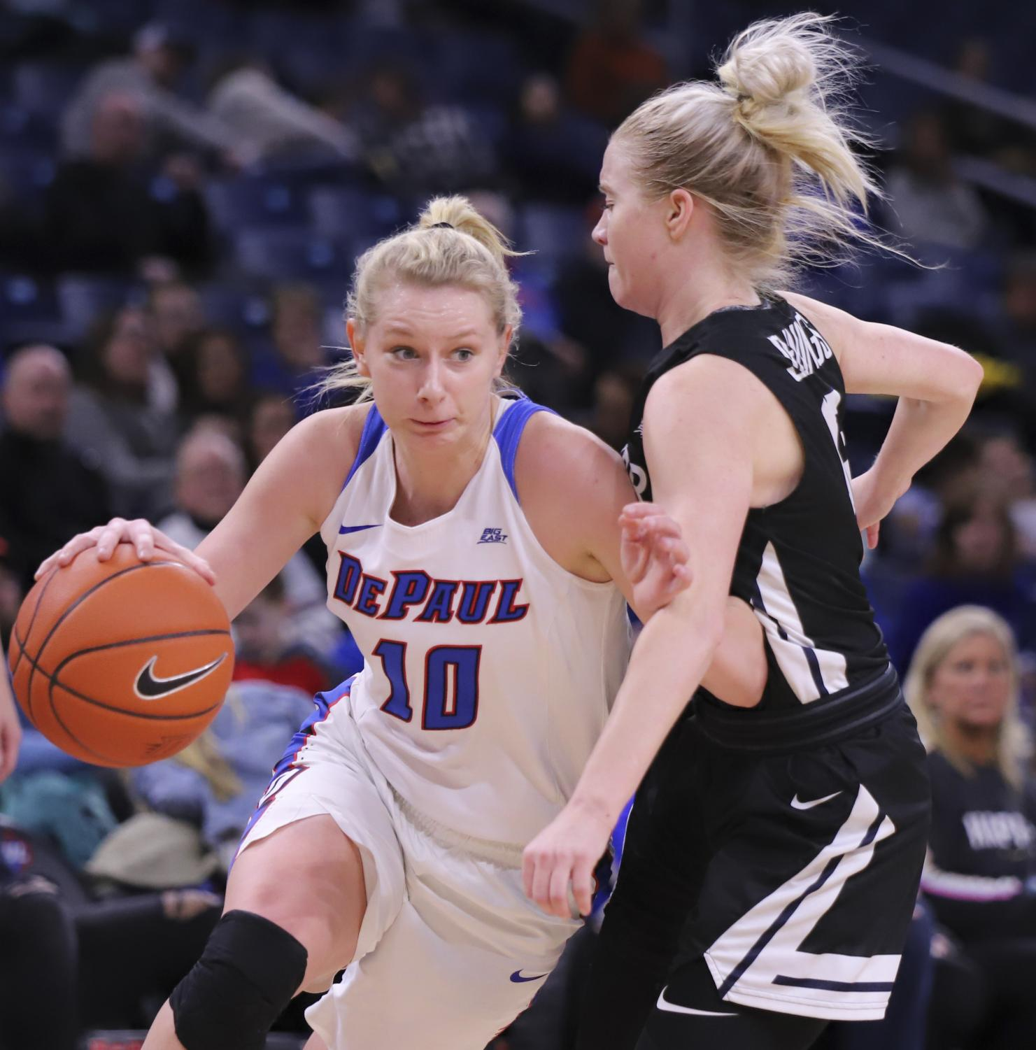 DePaul freshman guard Lexi Held drives to the basket against Butler's Whitney Jennings Sunday afternoon at Wintrust Arena. Alexa Sandler | The DePaulia