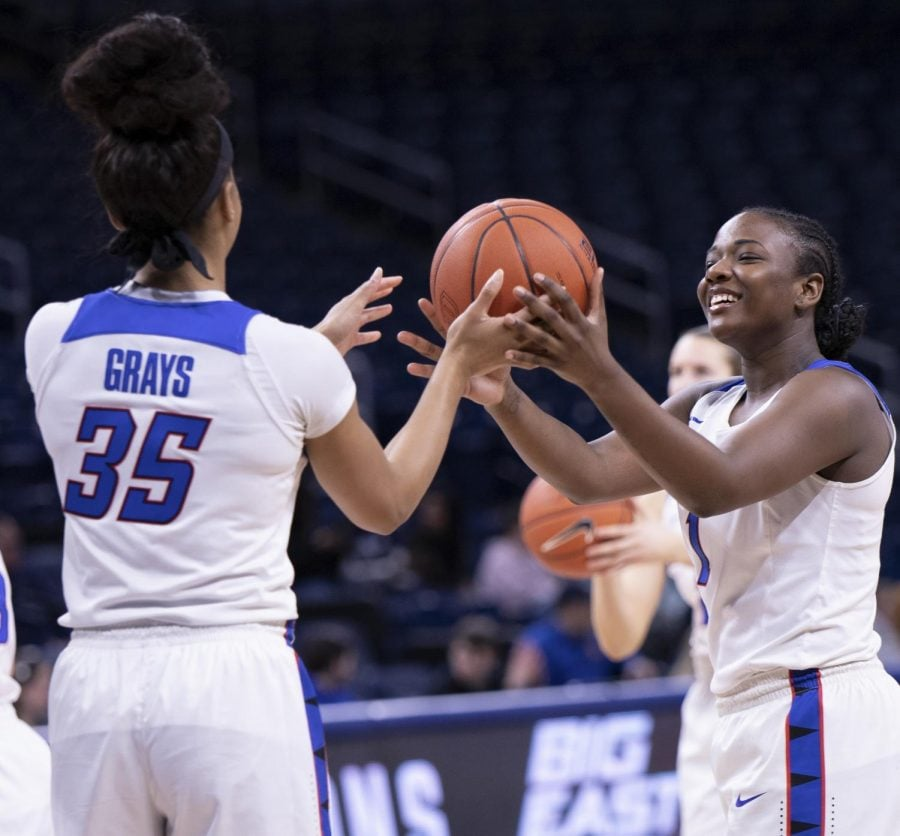 DePaul+senior+guard+Ashton+Millender+jokingly+hands+the+ball+over+to+fellow+senior+Mart%E2%80%99e+Grays+during+warmups+of+DePaul%E2%80%99s+Feb.+22+game+against+Xavier+at+Wintrust+Arena.+
