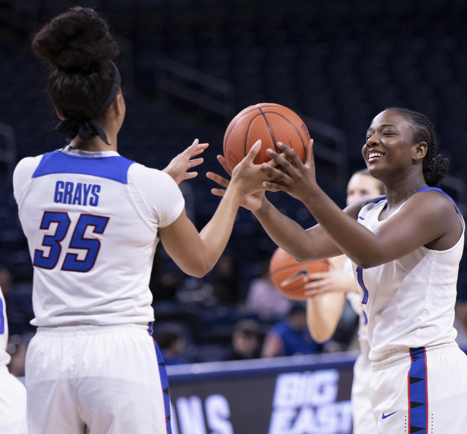 DePaul senior guard Ashton Millender jokingly hands the ball over to fellow senior Mart'e Grays during warmups of DePaul's Feb. 22 game against Xavier at Wintrust Arena.