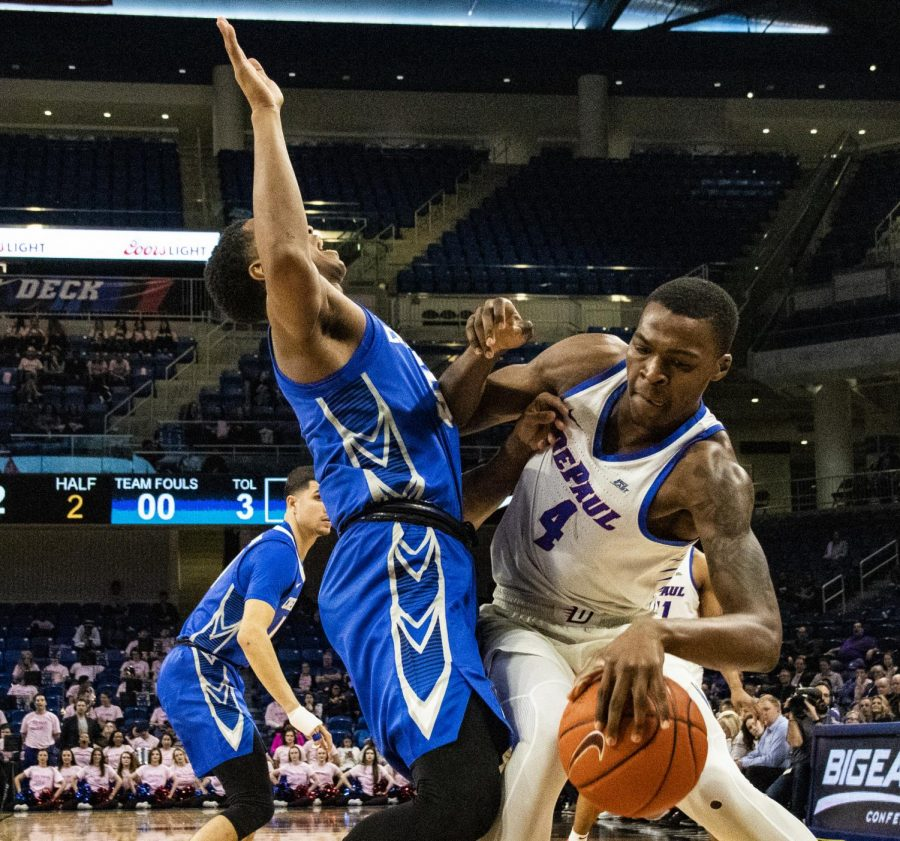 DePaul sophomore forward Paul Reed backs down Creighton guard Ty-Shon Alexander Wednesday night at Wintrust Arena. The Blue Demons lost the game 79-67.