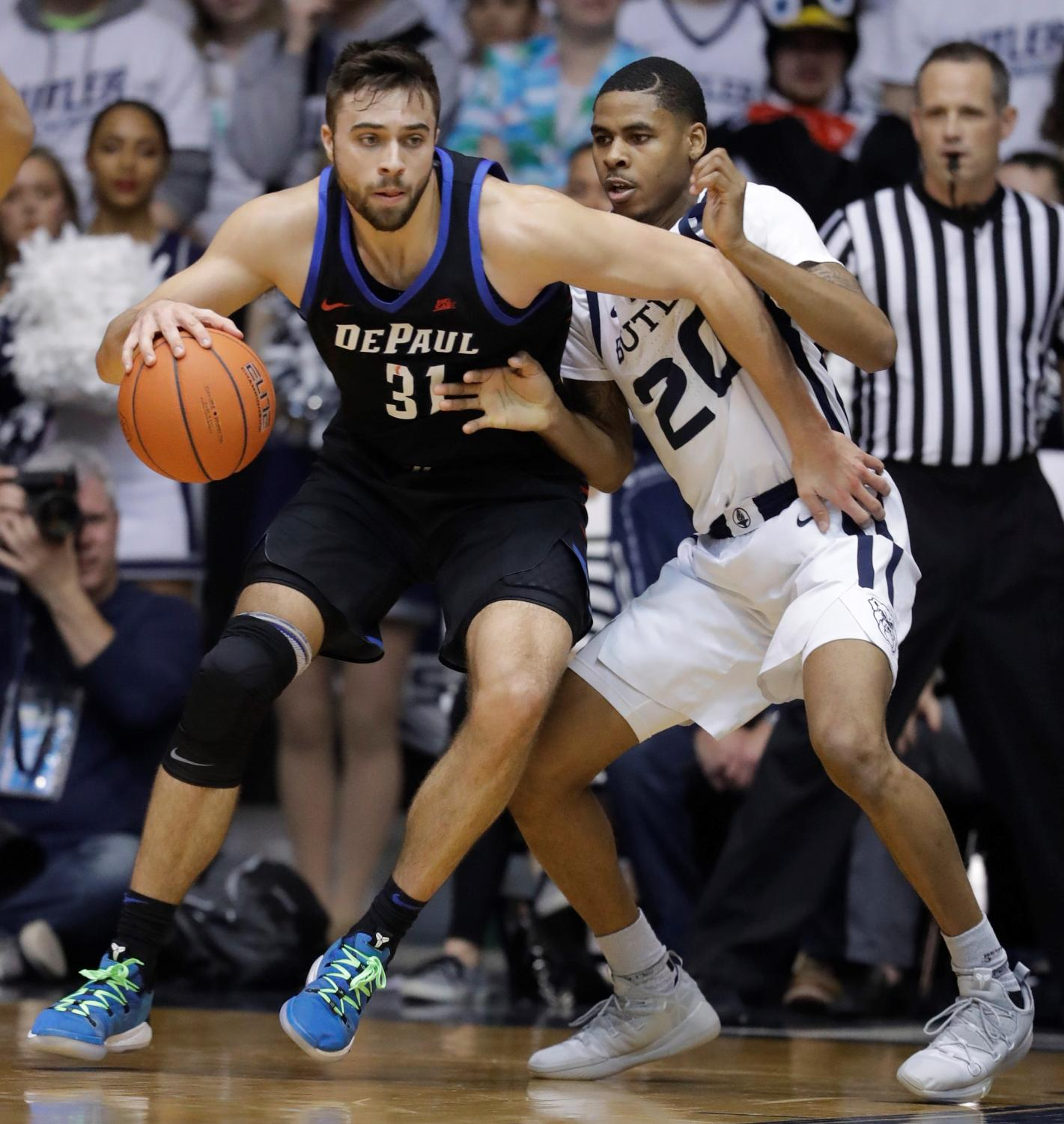 Senior guard Max Strus battles against Butler's Henry Baddley Saturday night at Hinkle Fieldhouse. Darron Cummings | AP