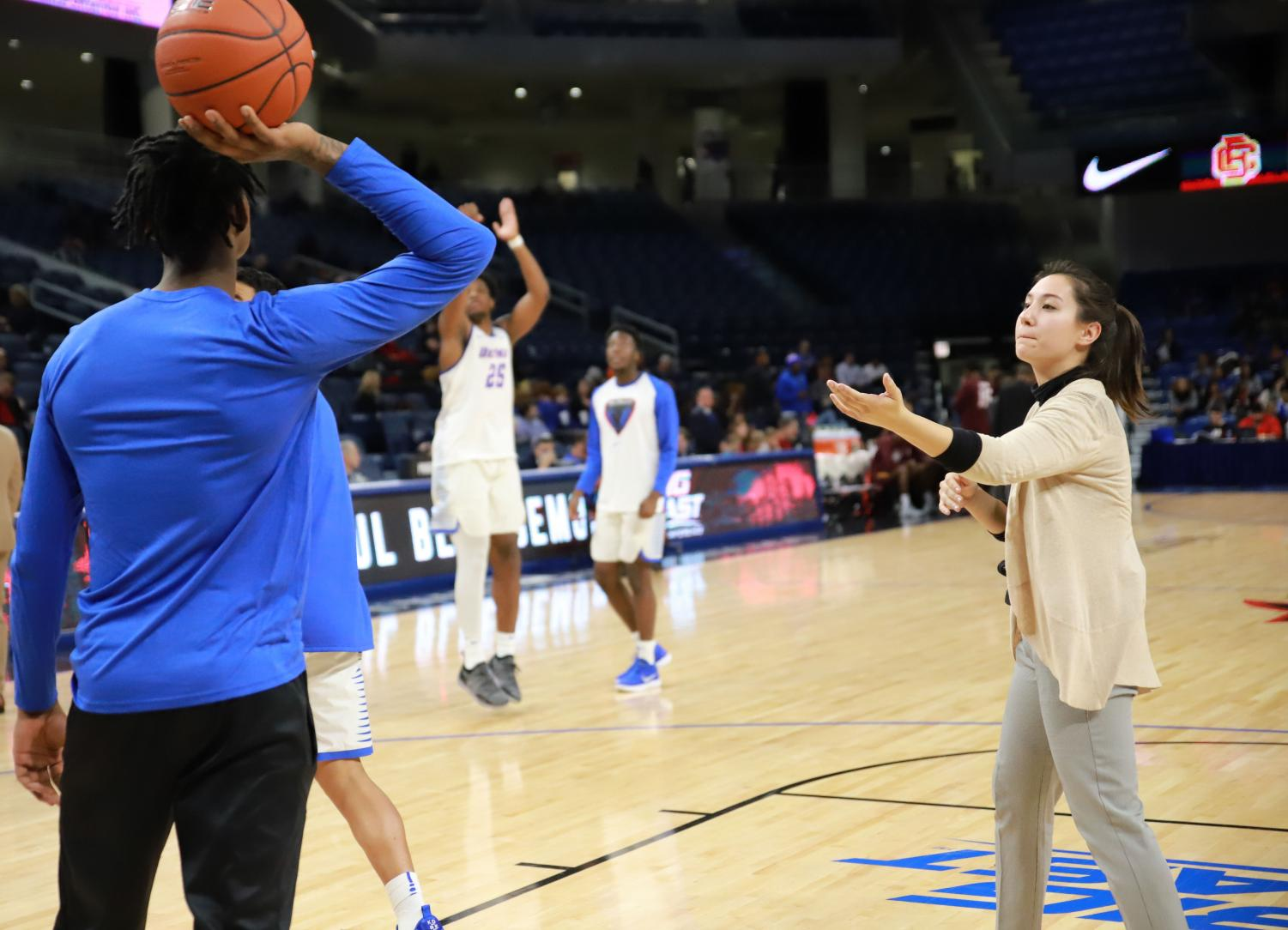 DePaul senior Maya Scanlon-Kimura asks for the basketball from sophomore forward Darious Hall during warmups prior to a Nov. 7 game against Bethune-Cookman.