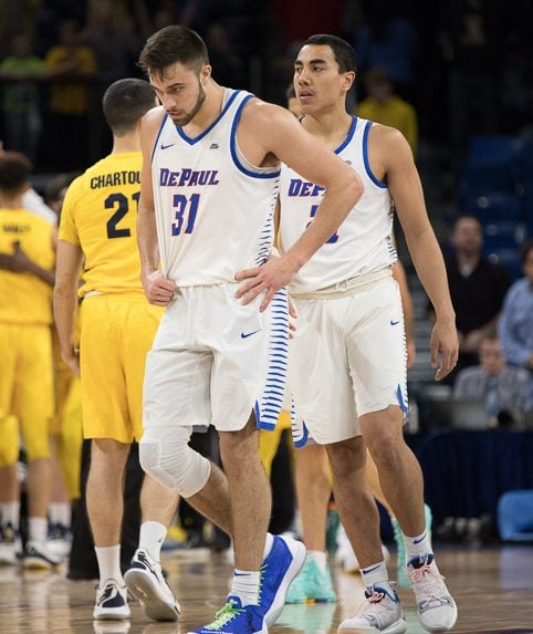 Senior guard Max Strus and freshman guard Flynn Cameron walk off the court following DePaul's 92-73 loss to Marquette Tuesday night. Will Barksdale | The DePaulia