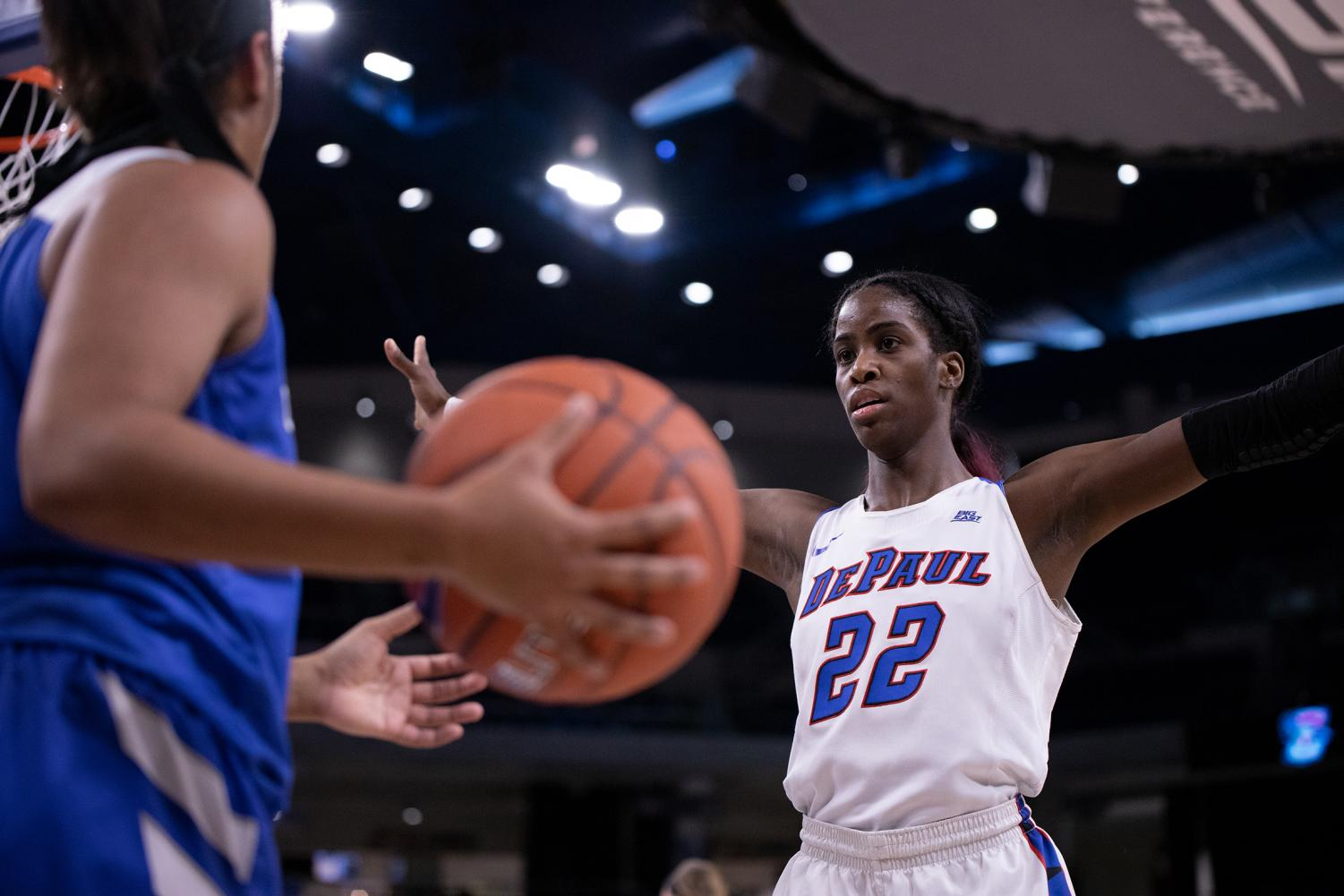DePaul junior forward Chante Stonewall defends an inbounds pass during the Blue Demons Big East Championship semifinal game against Wintrust Arena. Alexa Sandler | The DePaulia