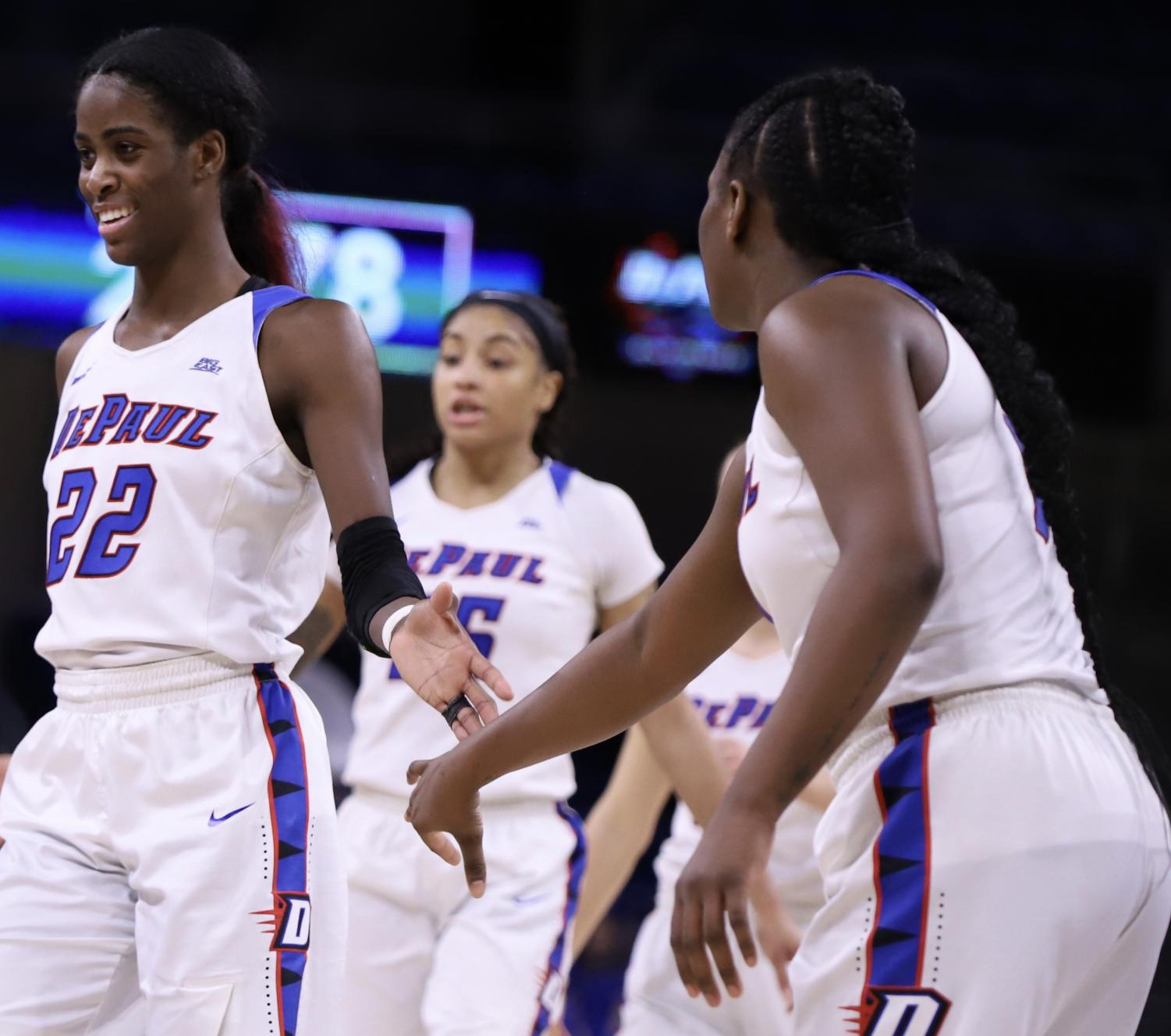 DePaul's Chante Stonewall, Mart'e Grays and Ashton Millender celebrate a play Monday night at Wintrust Arena. The Blue Demons advanced to the Big East Tournament championship game with an 80-69 victory over Creighton and will face Marquette for the third straight season. Alexa Sandler | The DePaulia