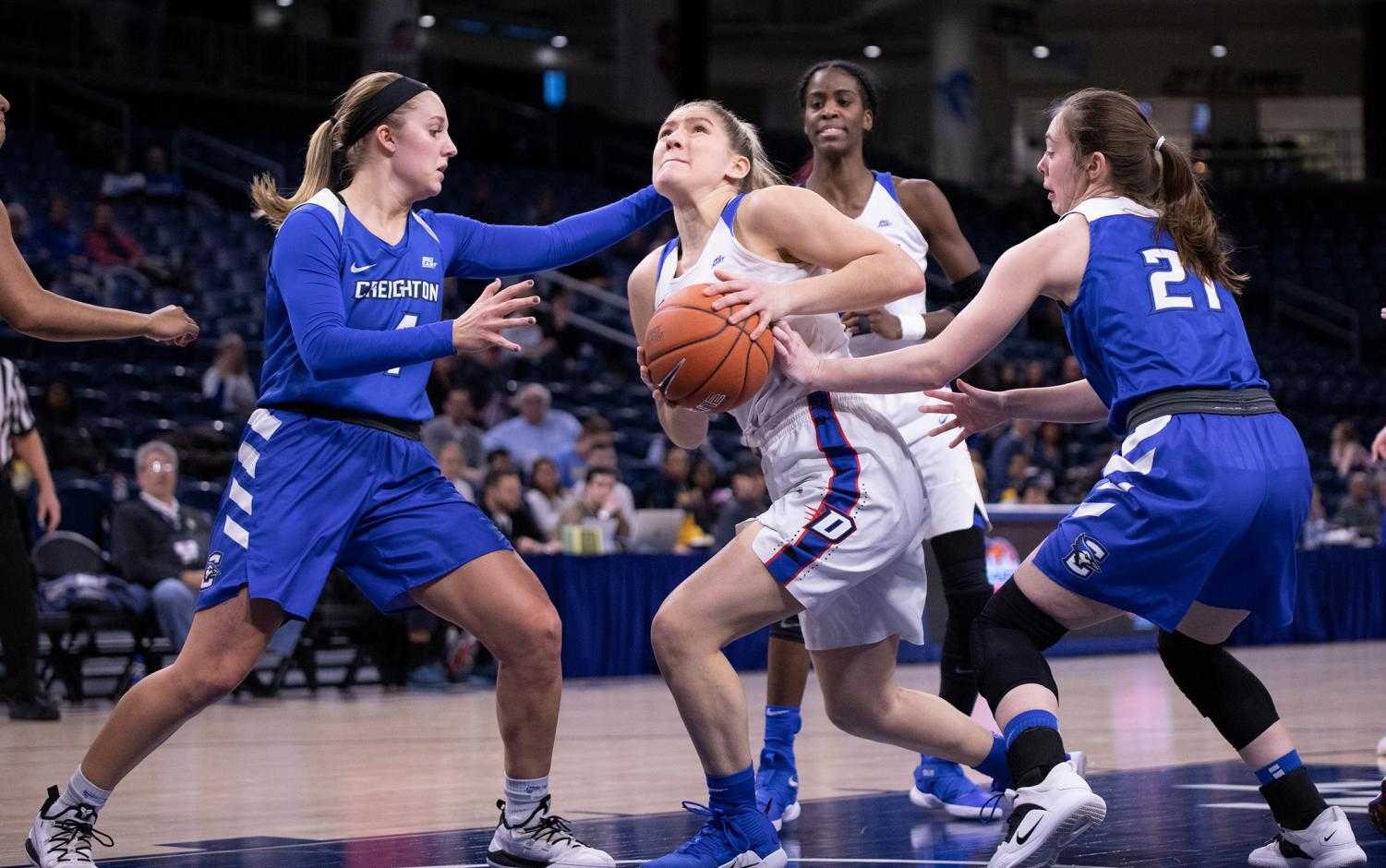 DePaul+sophomore+guard+Dee+Bekelja+winds+her+way+into+the+lane+with+two+Creighton+defenders+Temi+Carda+and+Olivia+Elger+challenging+Monday+night+at+Wintrust+Arena.+Bekelja+finished+with+four+points+in+18+minutes.+Alexa+Sandler+%7C+The+DePaulia