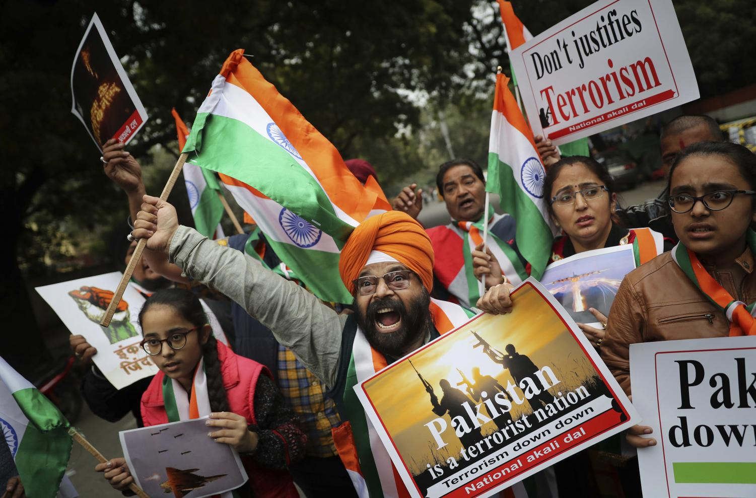 A National Akali Dal leader shouts slogans in support of India and against Pakistan as he celebrates reports of Indian aircrafts bombing Pakistan territory, in New Delhi, India, Tuesday, Feb. 26, 2019.