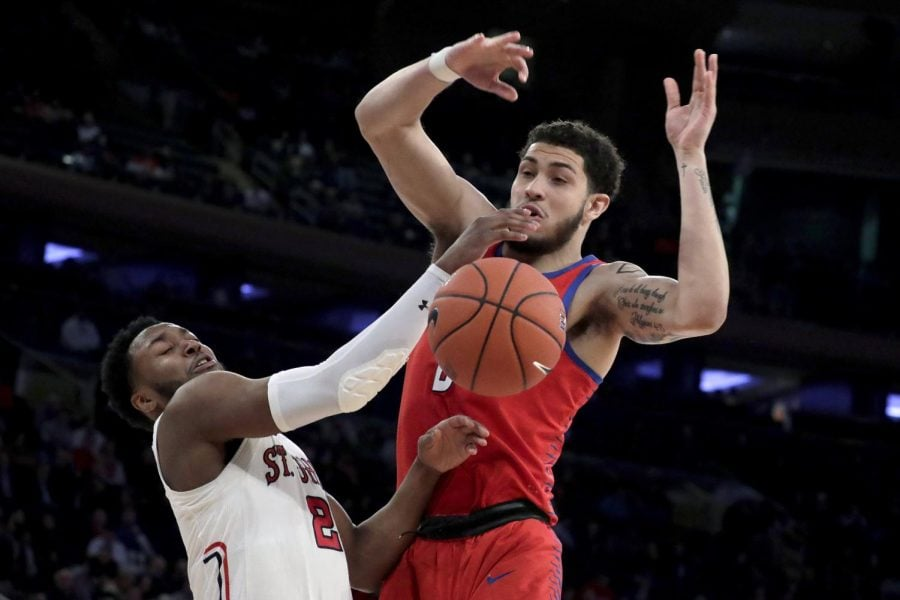 Sophomore forward Jaylen Butz loses the ball going up for a shot against St. John's guard Shamorie Ponds during the second half of the Big East men's tournament in New York. St. John's won the game 82-74. Julio Cortez | AP