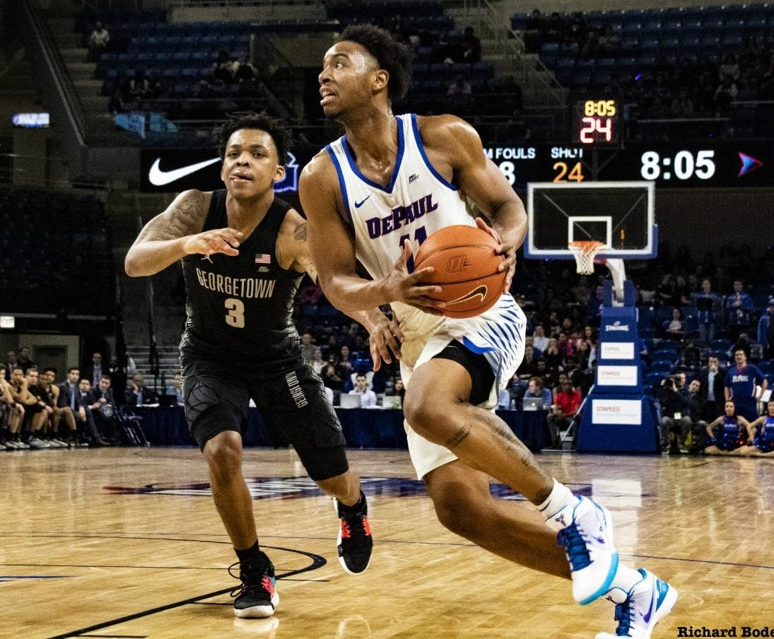 DePaul senior guard Eli Cain drives to the basket against Georgetown freshman James Akinjo on March 6 at Wintrust Arena. The Blue Demons square off against Central Michigan in the first round of the CBI tournament on Wednesday at 7 p.m. Richard Bodee I The DePaulia