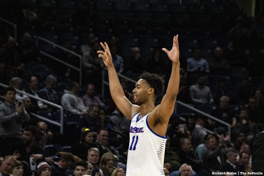 DePaul senior Eli Cain raises his hands in celebration as he leaves the court at the end of DePaul's 101-69 victory against Georgetown on Wednesday night. Richard Bodee I The DePaulia