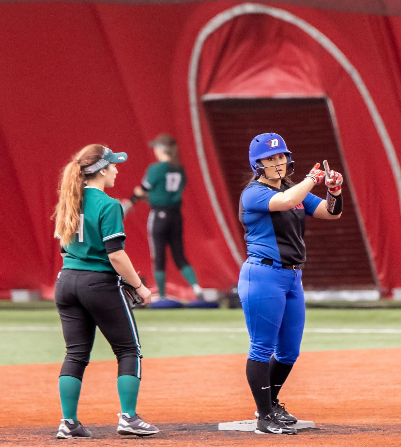 Sophomore catcher Jessica Cothern signals to the bench after a double during game against Green Bay on Feb. 9