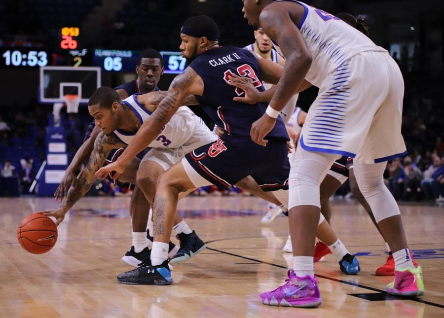 DePaul sophomore guard Devin Gage fights for a loose ball during the Blue Demons win over St. Johns Sunday on senior dat at Wintrust Arena. DePaul won 92-83.