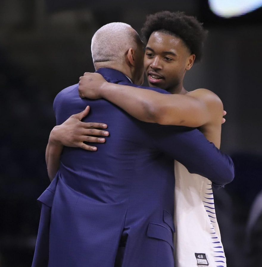 DePaul senior guard Eli Cain hugs head coach Dave Leitao at the end of the Blue Demons 101-69 win over Georgetown on March 6 at Wintrust Arena. Cain finished with 24 points and five assists as he scored at least 20 points for the fourth time this season.
