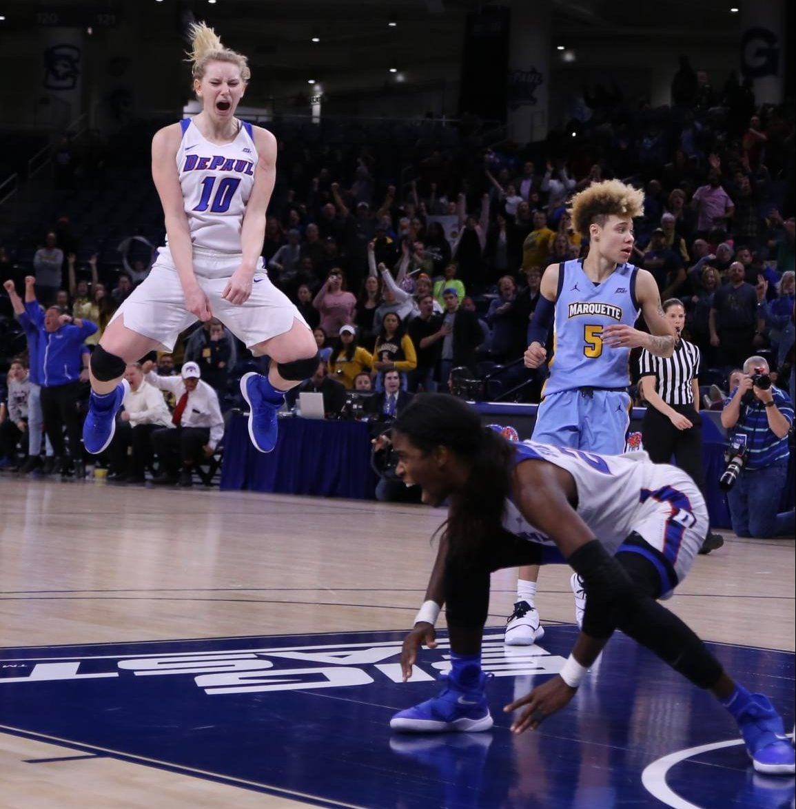 DePaul freshman guard Lexi Held reacts as junior forward Chante Stonewall slaps the floor after making the game-tying shot with five seconds left in the game against Marquette. Stonewall, Held, Sonya Morris and Kelly Campbell will represent DePaul in the  2019 USA Basketball 3×3 National Championships on Friday and Saturday in Las Vegas.