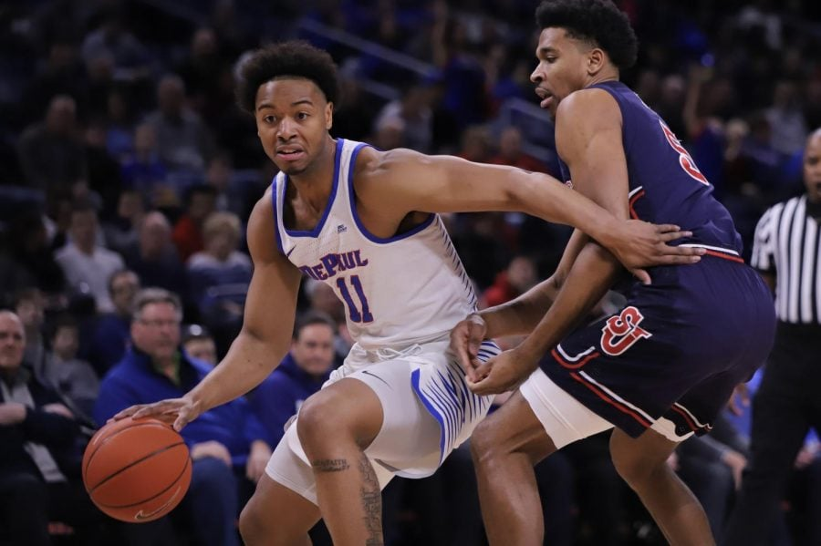 DePaul senior guard Eli Cain dribbles past St John's guard Justin Simon during DePaul's win over St. John's Sunday afternoon at Wintrust Arena. Alexa Sandler | The DePaulia