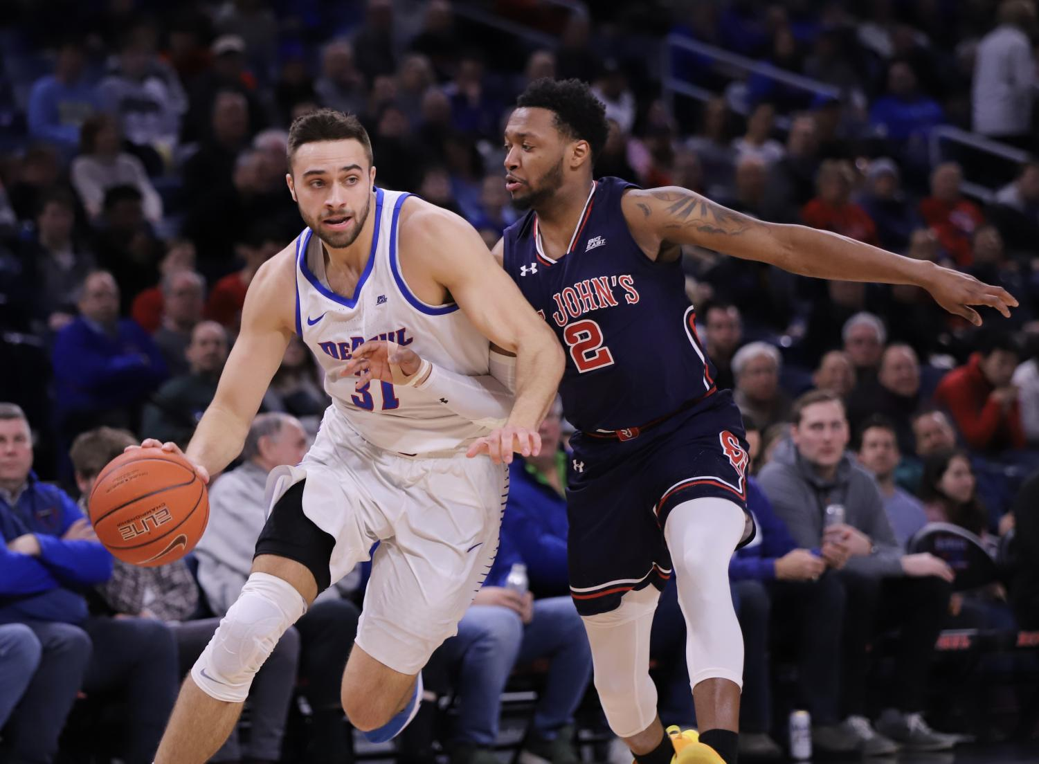 DePaul senior guard Max Strus drives past St John's guard Shamorie Ponds, who signed as an undrafted free agent with the Houston Rockets, during Sunday's game against St. John's at Wintrust Arena. Alexa Sandler | The DePaulia