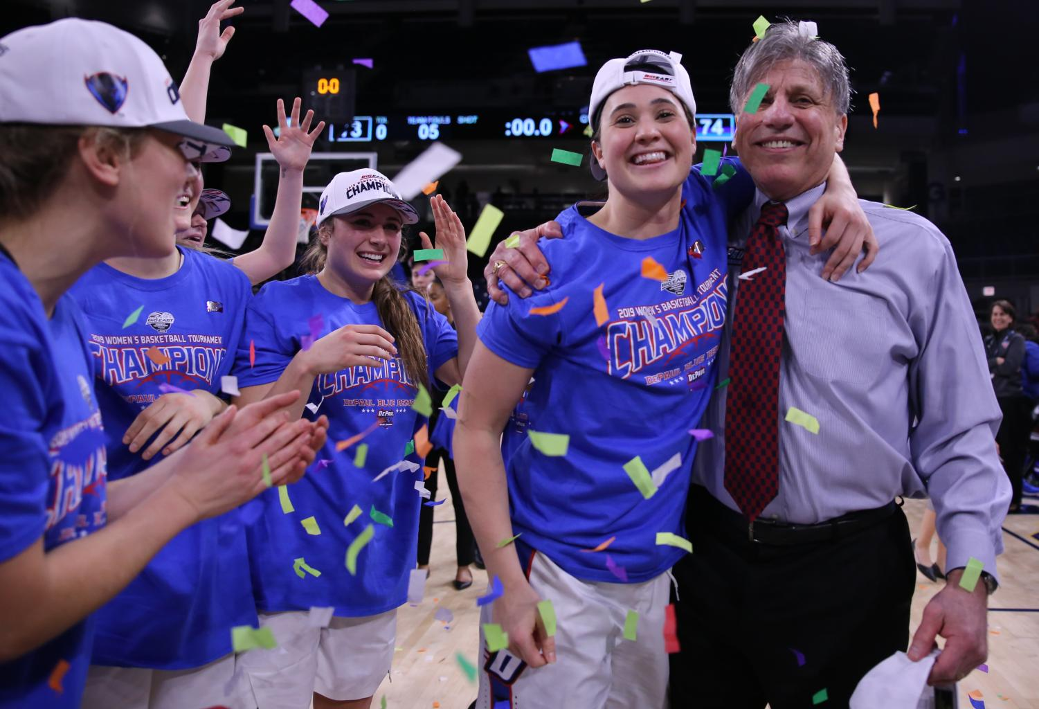 DePaul senior guard Rebekah Dahlman with head coach Doug Bruno for a picture after DePaul won its second consecutive Big East Tournament championship. Alexa Sandler | The DePaulia