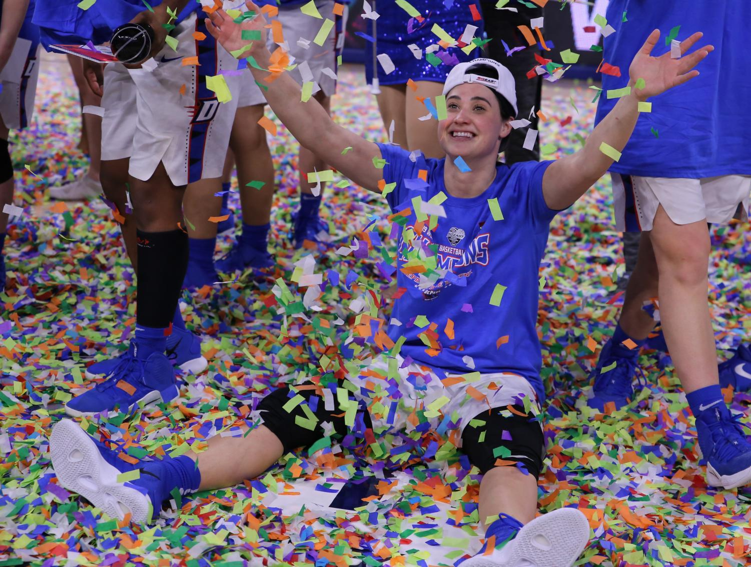 DePaul+senior+guard+Rebekah+Dahlman+sits+in+the+confetti+and+holds+her+hands+in+the+hair+after+the+Blue+Demons+topped+Marquette+in+the+Big+East+Tournament+championship+game+for+the+second+straight+year.+Alexa+Sandler+%7C+The+DePaulia