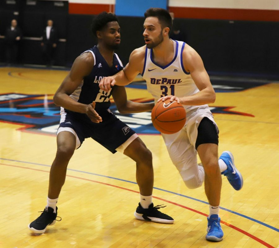 Longwood forward Jashaun Smith (right) defends DePaul guard Max Strus during the quarterfinals for the Roman College Basketball Invitational at the McGrath-Phillips arena on Monday. The Demons clinched the game, winning 97-89. Xavier Ortega | The DePaulia
