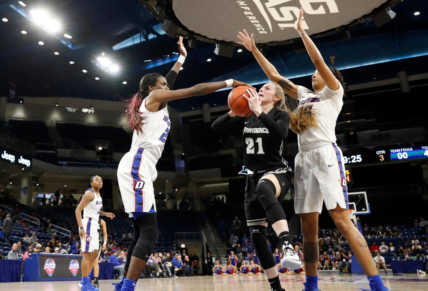 DePaul junior forward Chante Stonewall blocks a layup attempt by Providence senior Maddie Jolin during the third quarter of the Blue Demons win over the Friars Sunday night at Wintrust Arena. Steve Woltmann/BIG EAST