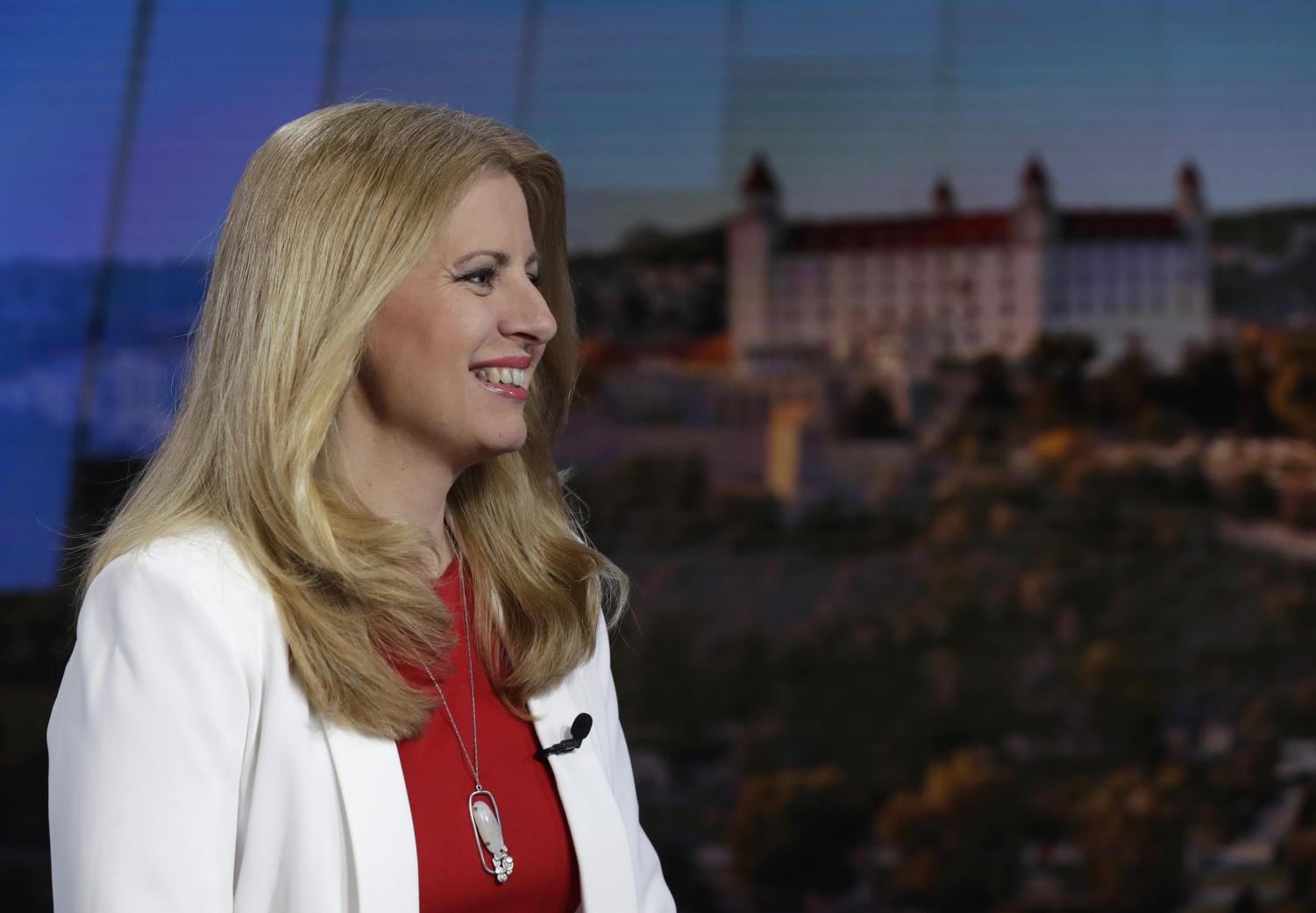 Newly elected Slovakian President Zuzana Caputova smiles in a TV studio prior a debate in Bratislava, Slovakia, Sunday, March 31, 2019. Caputova, a liberal environmental activist, has been elected as the first female president of Slovakia. The relative newcomer had 58 percent of the vote in Saturday's runoff election, topping rival Maros Sefcovic, who had 42 percent. (Petr David Josek | AP)