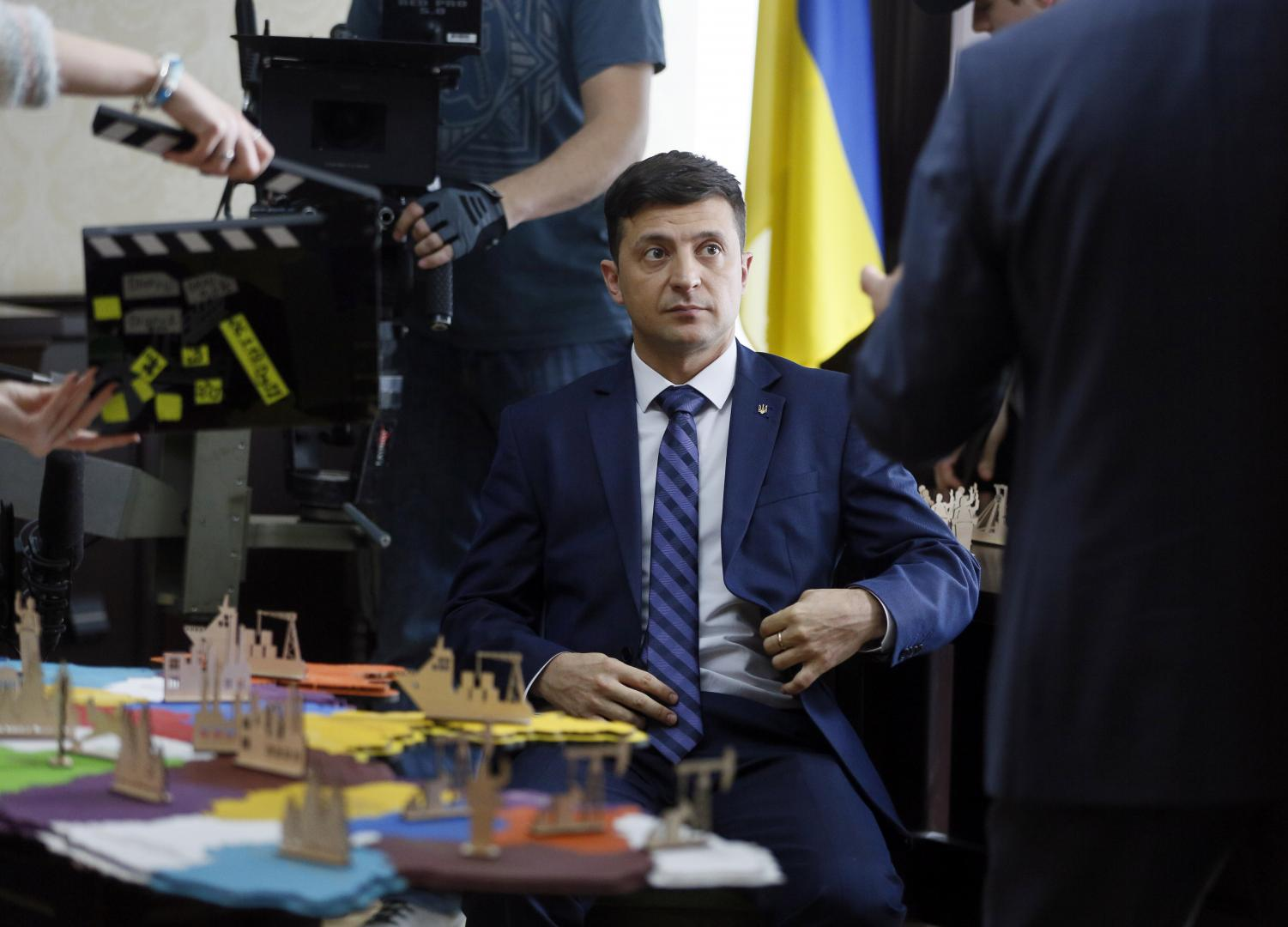 Ukrainian presidential candidate Volodymyr Zelenskiy being photographed on the set of his TV show 'Servant of the People,' where he plays a schoolteacher-turned-president. (EFREM LUKATSKY | ASSOCIATED PRESS)